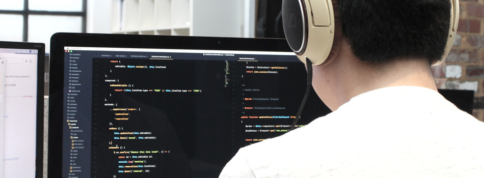 Building a website - person coding a website using behavioural insights